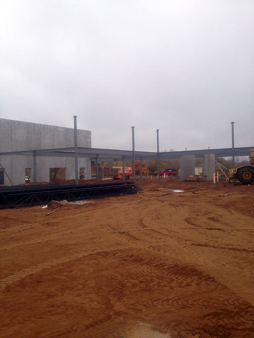 Building under construction, steel overhang and cement walls