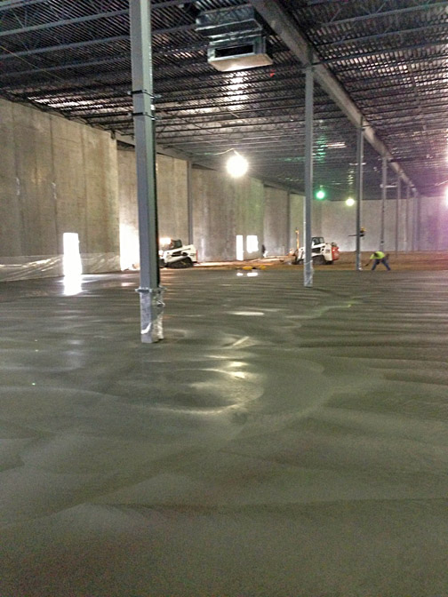 Pouring and finishing the warehouse floor.
