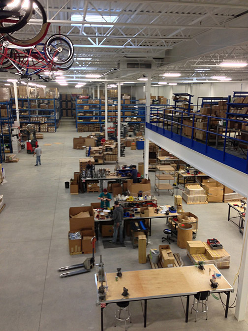 Above shot of Park Tool warehouse with workbenches and shelves of boxes