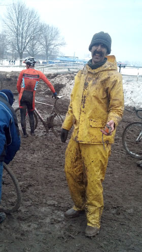 Calvin in a full yellow rain suit