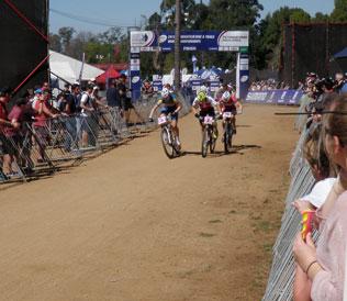 Three cyclists heading toward the finish line