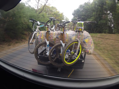 A view out the back of the DH shuttle. Three bikes run the large 203mm rotors