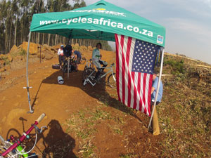 Cycles Africa tent with an american flag hung from the side