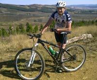 Paul Wood wearing a helmet standing next to a bike