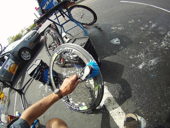 Mechanic washing bike wheel