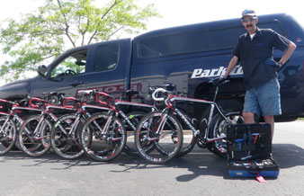 Calvin Jones posing in front of Park Tool truck next to a row of bicycles