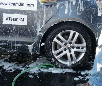Close up of a car wheel being washed