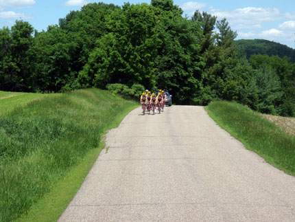 Far away shot of a group of cyclists