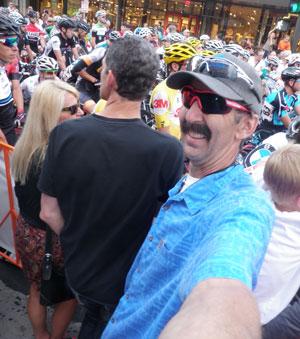 Calvin Jones taking a selfie in large crowd