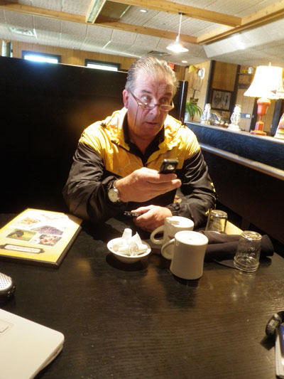 The classic cycling Team Manager, meeting with staff