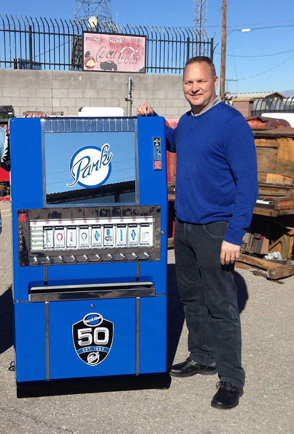 Eric Hawkins with vintage Park Tool vending machine made by American Restoration