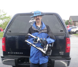 Calvin Jones decked out in Park Tool gear in front of a pick up