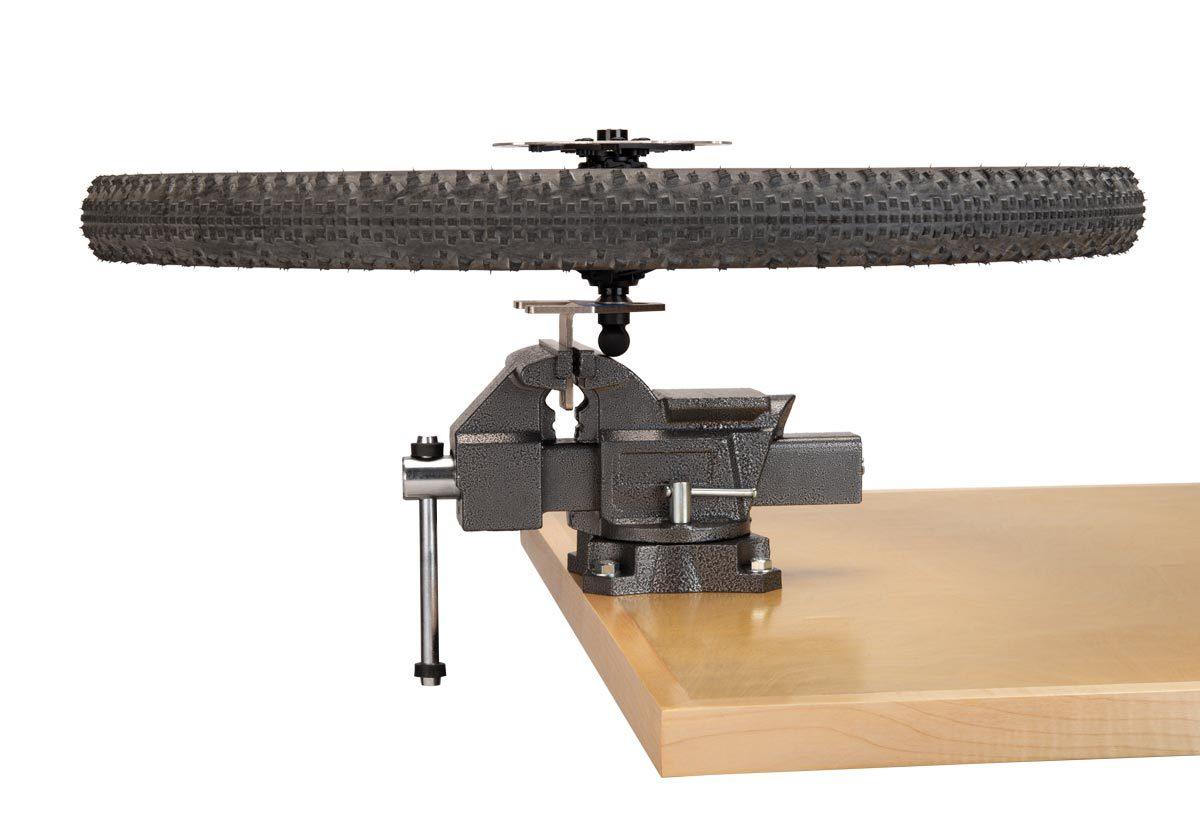 Park Tool WH-2 Wheel Holder holding wheel on work bench
