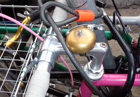 Brass bell on frame of bike