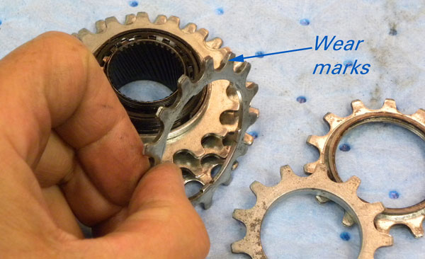 Heavy wear marks on the back of the cogs will probably cause issues when used