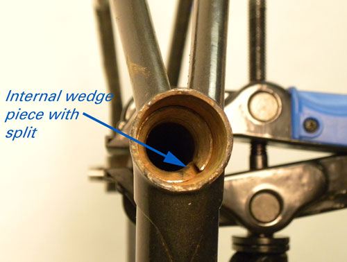 The Mont-Cenis seat post wedge is rusted in place.
