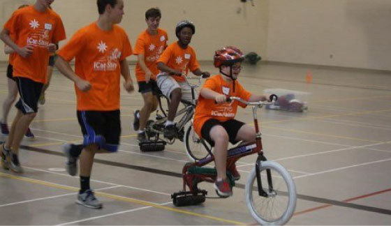 I can shine; Winners of community grant riding bike in indoor gym