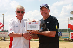Dean McCall (right) receives his recognition from the English Team Captain Pete Barnes.