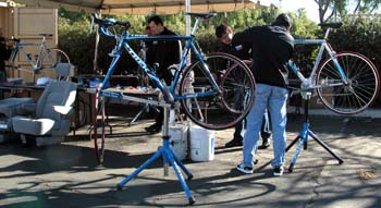 """The staff """"bike shop"""" is set up in a parking lot."""