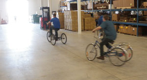 Park Tool engineers riding bikes in the warehouse
