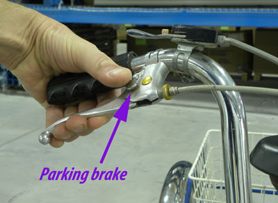 A locking parking brake on the industrial trike