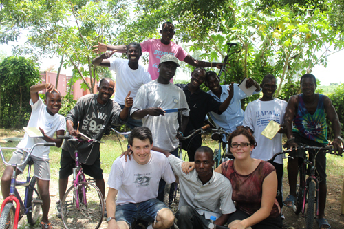 Group of young Haitian men with bikes