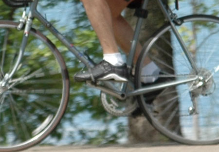"The rider here has developed a ""flat foot"" pedaling style, neither point down or up"