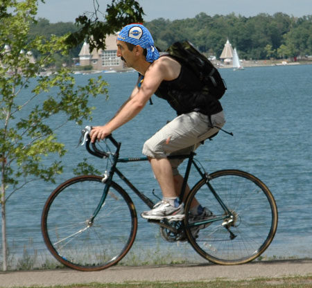 "Biker in a forward posture and has the option of lowering farther if he were to ride down on the ""drops"""