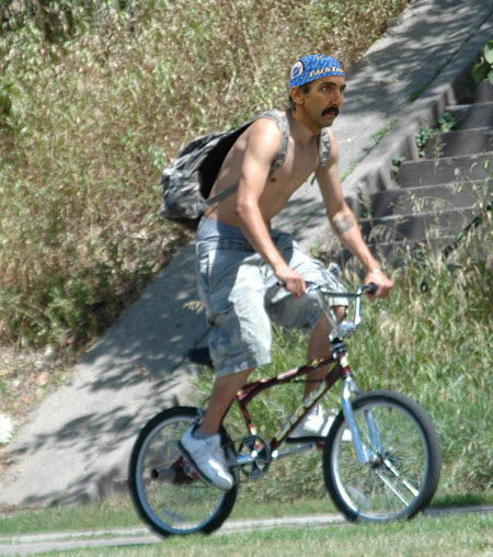The BMX bike on the bike path with typical rider posture