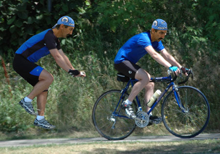 The posture that is on the left, cut from a MTB racing position, parallels the road bike posture on the right