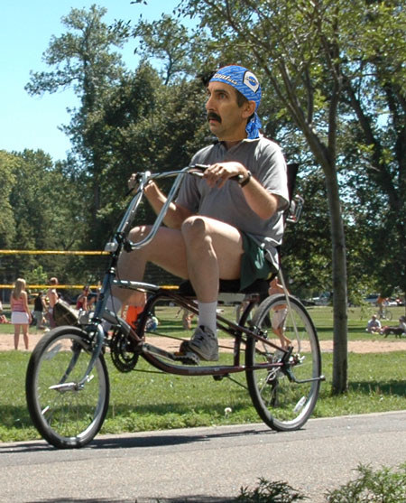 """A """"low"""" saddle on a recumbent bike. The seat should be moved back."""