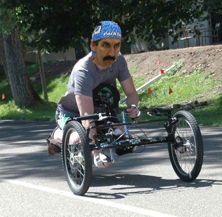 In this hand cycle design, the body weight is above the bottom bracket