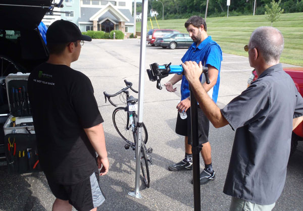 Tyler West of Shimano Multi-Services talks to a rider about saddle comfort