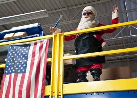 Santa statue holding bike wrench in Park Tool Warehouse next to American Flag