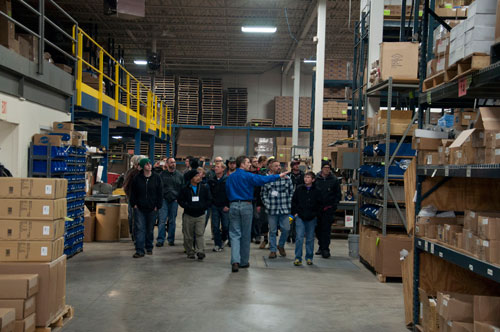 John Krawczyk leads a tour through our shipping and receiving department