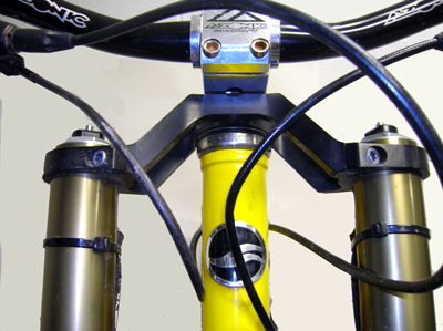 THE TALL OR RAISED CLAMP FOR TALLER HEAD TUBES.