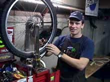 Scot Banks: Mr. Banks is service manager of Absolute Bikes in Salida Colorado. He is a USA Cycling licensed mechanic, has experience with Mavic Technical Support, and comes to cycling out of the high performance automotive industry. Scot is seen here finishing another wheel for the race.