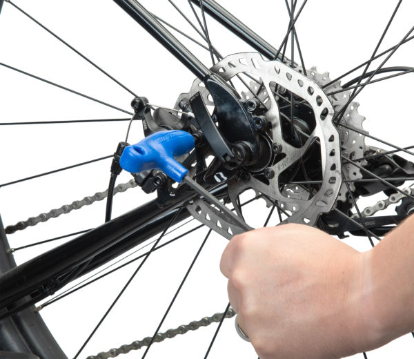 PH-5 5 mm hex wrench tightening a disc brake mount bolt, click to enlarge