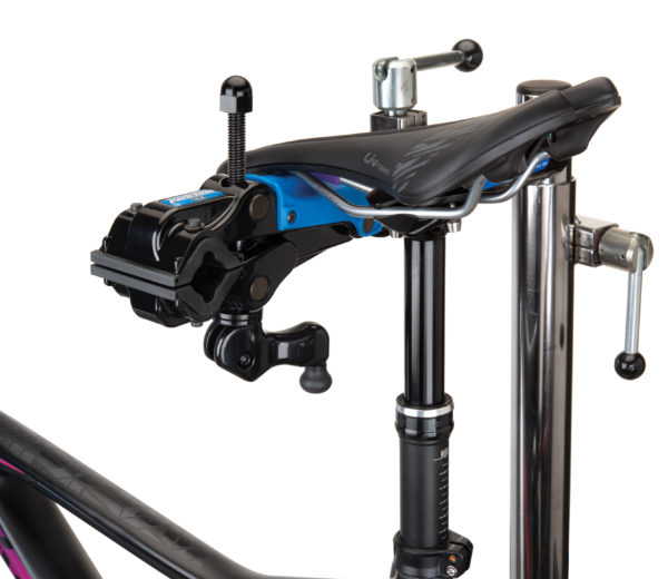 The Park Tool 100-3D Professional Micro-Adjust Clamp attached to stand with saddle resting on saddle cradle, click to enlarge