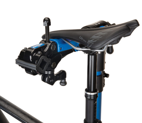 The Park Tool 100-5D Professional Micro-Adjust Clamp attached to stand with saddle resting on saddle cradle, click to enlarge