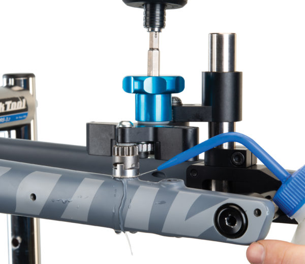 Machining fork caliper mount with drill using 2197 DT-5 / DT-5.2 Diamond Abrasive Adaptor for Carbon Fiber, click to enlarge