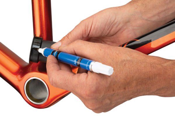Park Tool AP-1 Adhesive Primer being applied to PF30 bottom bracket, click to enlarge