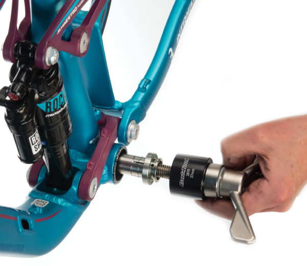 The Park Tool BBP-AOS Bottom Bracket Bearing Extractor Add-On Set pulling a bottom bracket bearing, click to enlarge