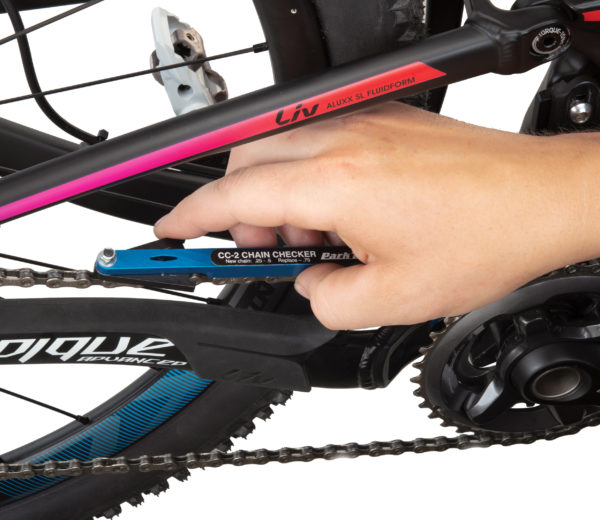 The Park Tool CC-2 Chain Checker mounted on chain on black mountain bike, click to enlarge