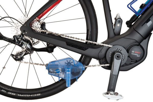 Park Tool CM-5.3 Cyclone™ Chain Scrubber installed on one way electrical bicycle chain, click to enlarge