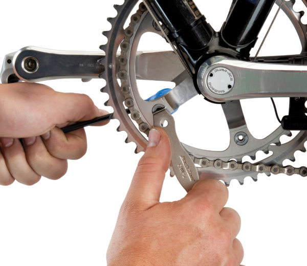 The Park Tool CNW-2 Chainring Nut Wrench engaged on slotted chainring nut, click to enlarge