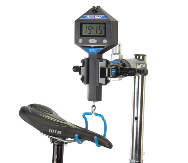 The Park Tool DS-1 Digital Scale weighing a mountain bike by its saddle, click to enlarge