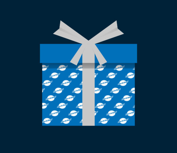 Illustration of a gift wrapped in blue Park Tool wrapping paper with a gray bow, click to enlarge