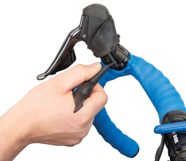 The Park Tool Bicycle Electronic Shift Tool removing E-TUBE® from Shimano® drop lever, click to enlarge