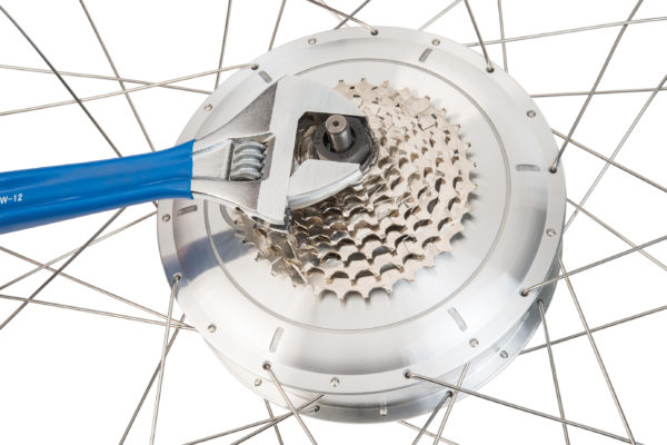 The Park Tool FR-1.3 Freewheel Remover installed on e-bike freewheel being removed by PAW-12, click to enlarge